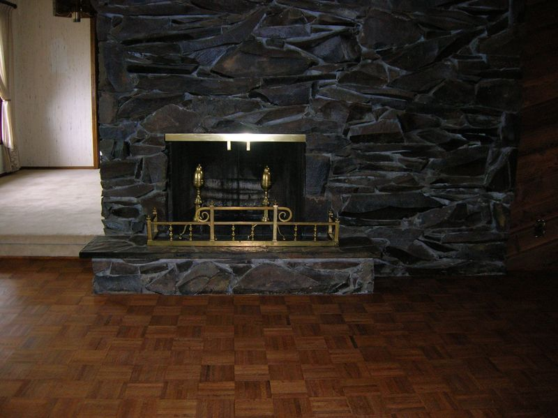 Living room fireplace and hardwood parquet floor